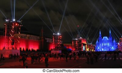 People walk on Red Square near Kremlin on First international festival CIRCLE OF LIGHT