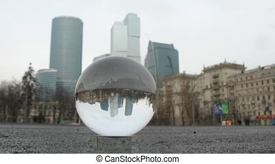 Center Moscow City is visible through transparent glass ball...