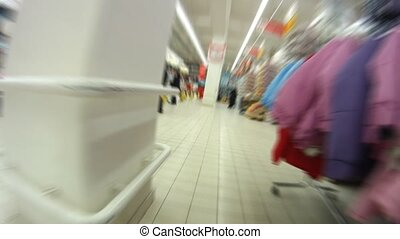 People walk and are engaged in purchases in shopping centre,...