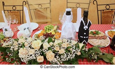 Festive table for wedding - Festive table with bottles,...