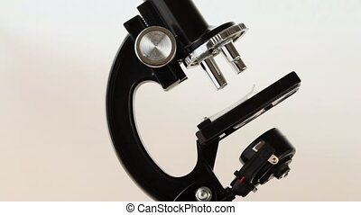 black brilliant small microscope rotates alone close up