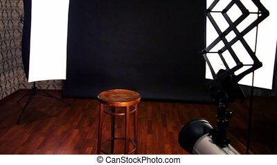 Professional equipment in small photo studio, upward motion