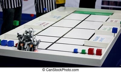 Referee watch on robot moves and stack at table edge