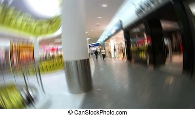 People visit shops of shopping center
