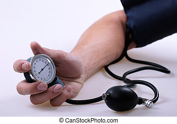 High pressure - tonometer in the male hand on white...