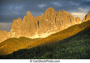 Sunset alpenglow on mountains - Sunset glow on mountains in...