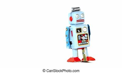 Simple toy robot walk at one place isolated at white...