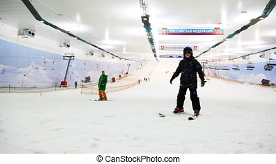 MOSCOW - FEB 28: Skier boy try to hold balance in ski resort...