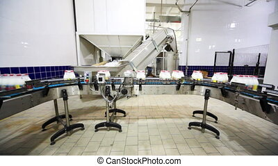 packets to eight bottles of milk move roller conveyor on...