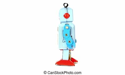 Simple toy robot walk isolated at white background