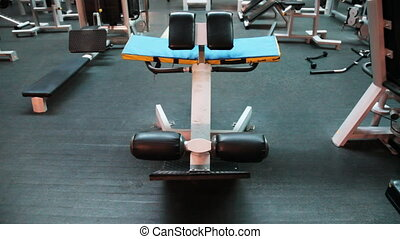simulator for muscles abdomen in large gym, panorama upward