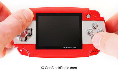 hands of man click on buttons portable game console,...