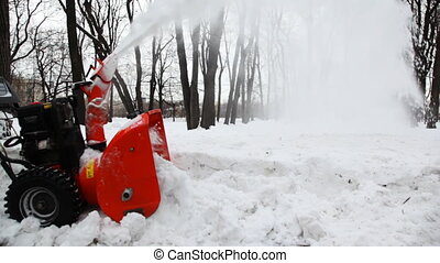small manual machine that breaks large snow lumps, and throws out