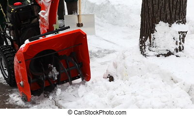 close-up of small manual machine that breaks large snow...