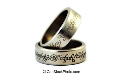 two silver wedding rings with engraved ancient inscriptions...