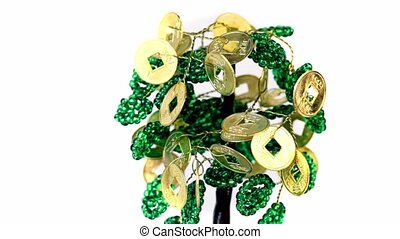 Artificial money tree spins isolated on white background,...