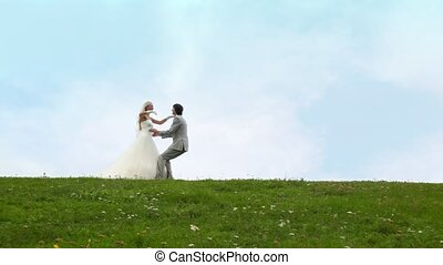 Newly-married couple runs to each other, embraces, then...