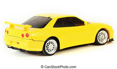 toy car standing on white background, hand man raises and...