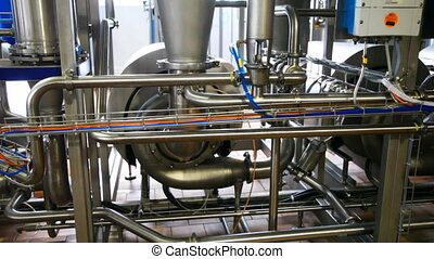 dairy equipment and pipes, panorama from bottom up