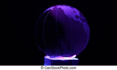 Cube emits color light and sphere with world map on it spin...