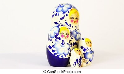 Four russian nesting dolls stand grouped and spin isolated...