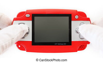 hands in white gloves click on buttons portable game console