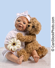 Baby Doll and Teddy - Teddy Bear embracing Baby Doll and...