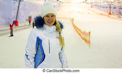 blonde nice girl gestures shows her delight in indoor ski