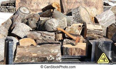 log splitter - gas powered log splitter splitting a log
