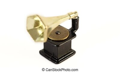 Toy vintage phonograph circling isolated at white background