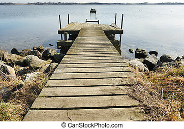Old wooden pier on the lake
