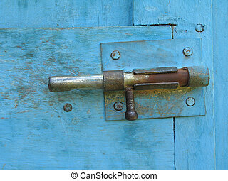an old lock on a blue doo