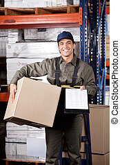 Supervisor With Clipboard And Cardboard Box - Portrait of...