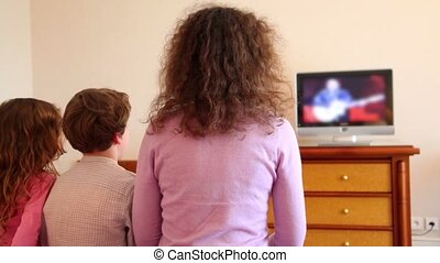 Mother with kids boy and little girl sit watch tv - Mother...