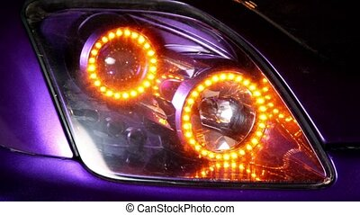 Automobile led dual headlight blinks, closeup view