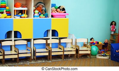 kindergarten room with colorful toys on shelves, panorama