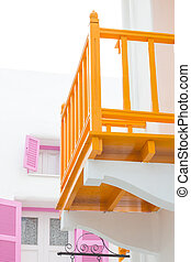 White house with balcony orange color