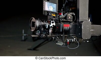 Video is on display of professional video camera in metal...