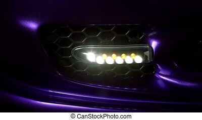Automobile small led headlight blinks, closeup view
