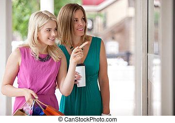 Shopping Women - Two happy window shopping women looking at...