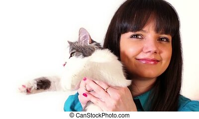 Young girl hold cat on hand, isolated on white background