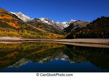 Fall Reflections 2 - High mountain lake in the fall showing...