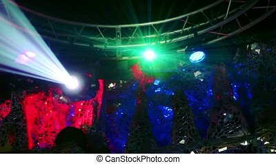 Lasers emit rays and light projector - Lasers emit green...