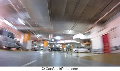 Car goes between other cars in underground parking, time...
