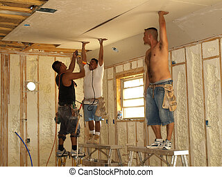 Hands Up - Holding the sheetrock in place