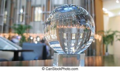 In glass ball is reflected business center hall, time lapse