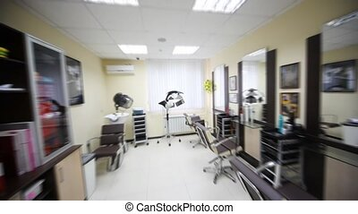 Flying motion of camera in hairdressing salon along...