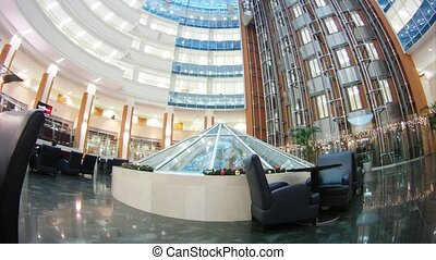 In hall of business-center go lifts upwards and downwards -...