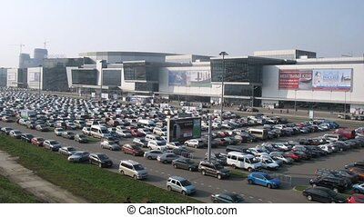Cars leave and come on a parking to Crocus Expo - MOSCOW -...