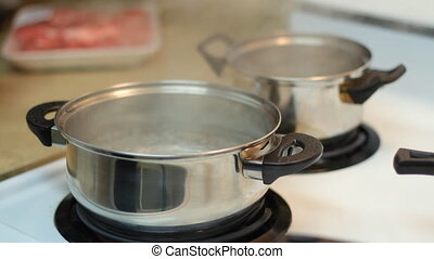Pot full of boiling water on the electric stove
